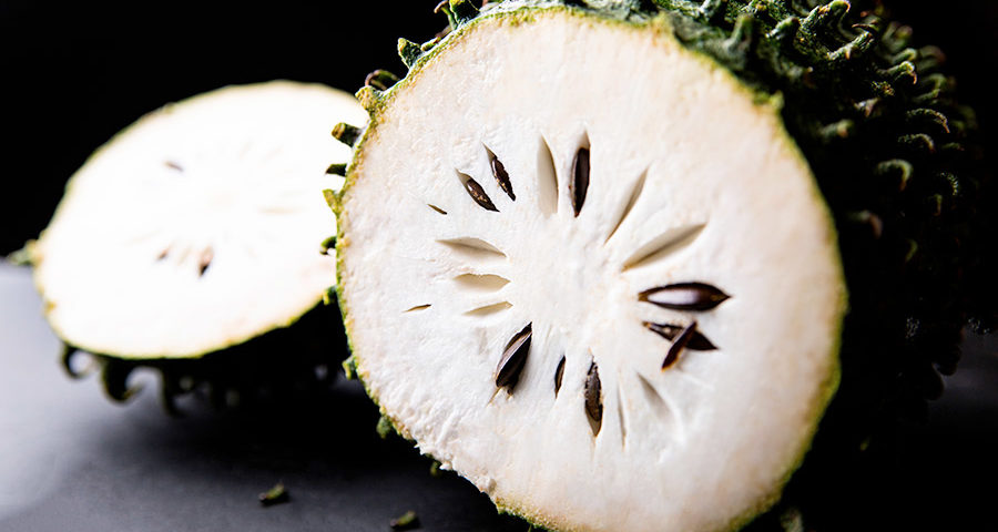 Graviola - Spiky green fruit with a white pulp